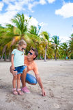 Young dad and cute daughter in palm grove during Royalty Free Stock Photo