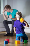 Young dad having headache Royalty Free Stock Images