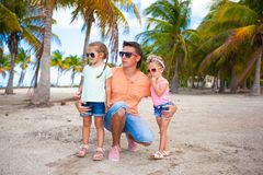 Young dad and his cute fashion daughters on Royalty Free Stock Image