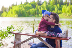 Young dad and his little daughter on pier by the Royalty Free Stock Images