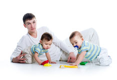 Young dad with his twin sons Royalty Free Stock Images