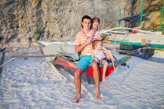 Young dad and his two little girls on a boat at Stock Images