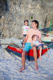 Young dad and his two little girls on a boat at Royalty Free Stock Image
