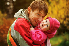 Young dad holds her little daughter Royalty Free Stock Photo