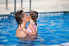 Young dad and little daughter playing in swimming Royalty Free Stock Photography