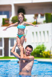 Young dad and little daughter playing in swimming Royalty Free Stock Photos