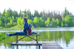 Young dad and little girl fishing on the lake Stock Photography