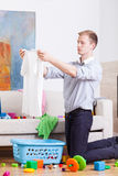 Young dad preparing laundry Stock Images