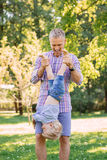 Young dad spending time with his son in the park Royalty Free Stock Image
