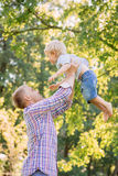 Young dad spending time with his son in the park Royalty Free Stock Photos