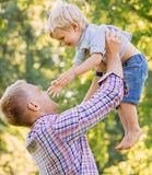 Young dad spending time with his son in the park Stock Photo