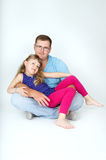 Young daddy keeps daughter in her arms Royalty Free Stock Image