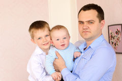 Young daddy and two little sons Royalty Free Stock Image