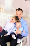 Young daddy and two little sons Royalty Free Stock Photo