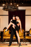 Young dance couple preforming latin show dance in ancient ballro Royalty Free Stock Images