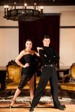 Young dance couple preforming latin show dance in ancient ballro Stock Photo