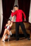 Young dance couple preforming latin show dance in ancient ballro Stock Photos