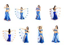 A young dancer in blue clothes performs an oriental belly dance. Isolate. Beautiful girl in bright national clothes dancing on white background Royalty Free Stock Photos