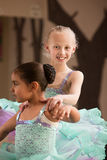 Young Dancer Helps Partner Royalty Free Stock Photography