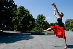 Young dancer jumping in park royalty free stock photo