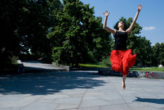 Young dancer jumping in park Royalty Free Stock Photography