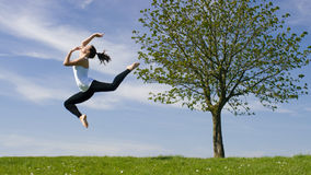 Young dancer jumps in the air outside Royalty Free Stock Images