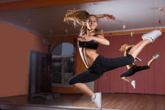 Young Dancer Leaping in Air in Dance Studio Royalty Free Stock Image