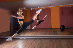 Young Dancer Leaping in Dance Studio with Mirrors Stock Photography