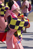 Young dancer in pink dresses on the Japanese traditional parade on EXPO 2015 Royalty Free Stock Photography