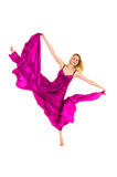 Young dancer in rosy fabric stretching Stock Image