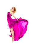 Young dancer in rosy gown jumping Stock Photography