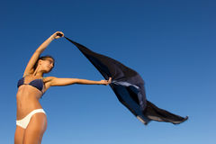 Young dancer with scarf at the beach Stock Photos