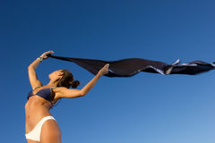 Young dancer with scarf at the beach Royalty Free Stock Photography