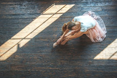 Young dancer sitting in dance studio Stock Photos