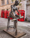 Young Dancer Statue and Red Telephone Booths in Covent Garden, London. The Young Dancer Sculpture by Enzo Plazzotta Against Red Telephone Booths on Broad Street Stock Photo