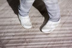 Young dancer in white sneakers. Stock Images