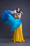 Young dancer in yellow costume dance with fantail Stock Photography