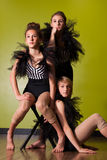 Young dancers in ballet costumes. Three young dancers posing in black ballet tutu costumes in a dance studio Royalty Free Stock Images