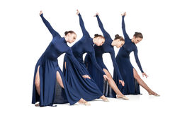 Young dancers dancing over white backgroud royalty free stock photo