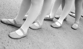 Young dancers waiting .. Young classic dancer's feets waiting for the exibition during a parade in Italy Stock Image