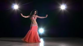 Young dancing belly dancer girl on black, back stock video footage