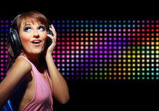 young dancing girl in headphones Stock Photos