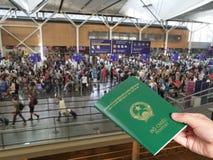 Young hand handing Vietnamese passport stock image