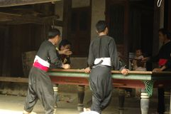 Young Dao ethnic playing snooker. The weekly market of Muong Hum near the Chinese border is the place to get supplies but also a place for romance and Stock Images