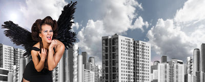 Young dark angel woman Royalty Free Stock Photos