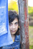 Young dark-haired girl with expressive eyes in the village outdoors. Portrait of a young dark-haired girl with expressive eyes in the village outdoors royalty free stock image