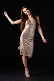 Young dark haired woman in evening dress dancing, vertical Royalty Free Stock Images