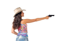 Young dark haired woman wear a hat aim a gun. Isolated on white background Royalty Free Stock Photo