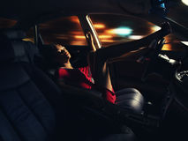 Young dark-skinned female driving a car Stock Image