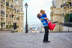 Young dating couple hugging on Montmartre Royalty Free Stock Images